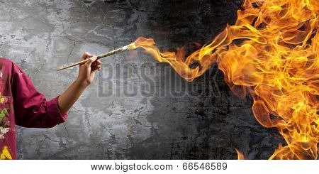 Young handsome man painter with brush in hand
