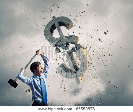 Young businessman crashing with hammer stone dollar symbol