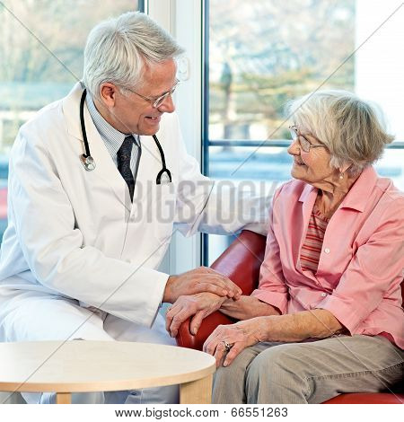 Elderly Woman In Consultation With Her Doctor