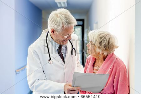 Doctor Talking To Old Woman About Good Results.