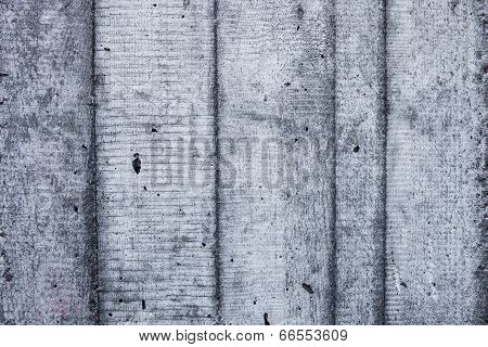 Grey Concrete Wall With Hardened Traces Of The Shuttering Moulds