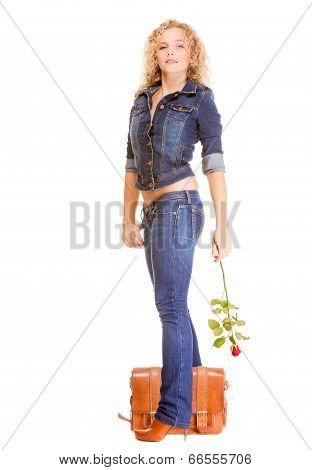 Denim Fashion. Full Length Student Girl In Blue Jeans Bag Holds Red Rose