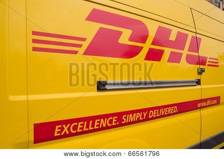 VALENCIA, SPAIN - JUNE 10, 2014: A DHL delivery van on the street in the city center of Valencia. DHL is a world wide courier company that operates in 220 countries with over 285,000 employees.