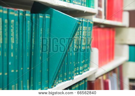 Book In A Bookshelf Standing Out At University Library