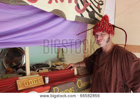 MUSKOGEE, OK - MAY 24: A merchant shows off crafts at his sale stand at the Oklahoma 19th annual Renaissance Festival on May 24, 2014 at the Castle of Muskogee in Muskogee, OK.