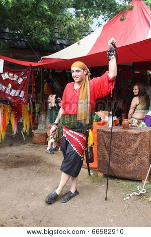 MUSKOGEE, OK - MAY 24: A business owner shows off his crafts for sale during the Oklahoma 19th annual Renaissance Festival on May 24, 2014 at the Castle of Muskogee in Muskogee, OK.