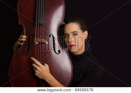 Beautiful Brunette Holding Cello With Selective Light In Black Dress