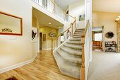 stock photo of staircases  - View of elegant staircase with wooden white and brown railings in modern large house - JPG