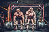 image of lifting weight  - Powerlifter with strong arms lifting weights - JPG