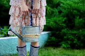 picture of woman boots  - Young woman in rubber boots holding watering can - JPG