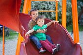 stock photo of toboggan  - Kids playing on the playground having fun - JPG