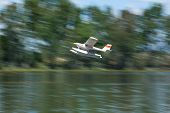 pic of hydroplanes  - Radio controlled Hydroplane flying over the Guadiana river surface Badajoz Spain - JPG