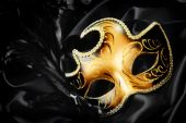 stock photo of masquerade mask  - Ornate carnival mask on black silk background - JPG