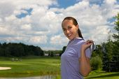 picture of ladies golf  - Female golfer stretching with a golf club - JPG