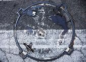 foto of cross-hatch  - Manhole with metal cover in asphalt with white zebra crossing marking line on it - JPG
