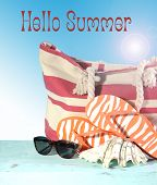 foto of blue things  - Summer vacation holiday gear with red and white strip beach bag flip flop things shell and sun glasses on a aqua blue table against a blue sunny sky with sample text or copy space - JPG