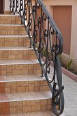 picture of wrought iron  - steps of the house detail of wrought iron railing with beautiful ornaments  - JPG
