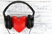 picture of heart sounds  - Headphones and heart on wooden background - JPG