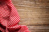 foto of wooden basket  - Checkered tablecloth on wooden table - JPG