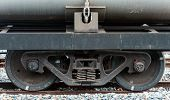 foto of railroad yard  - Steel wheel of the oil freight train in the railway yard - JPG