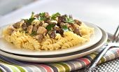 foto of morel mushroom  - Spiral pasta with morel mushrooms on a plate - JPG