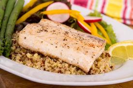 stock photo of magi  - cooked mahi mahi fish fillet dish on quinoa with vegetables - JPG