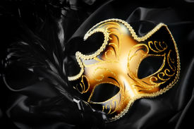 picture of masquerade mask  - Ornate carnival mask on black silk background - JPG