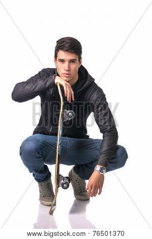 Handsome Young Man Resting Head On Skateboard
