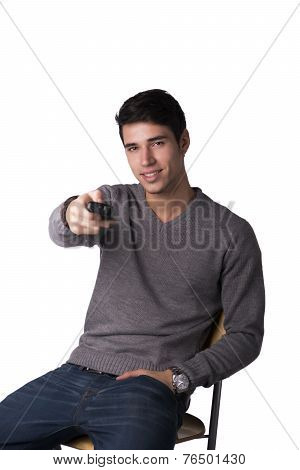 Attractive Young Man Holding Remote Control And Changing Tv Channels