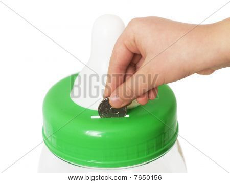 Coin In Fingers Of A Hand And A Coin Box