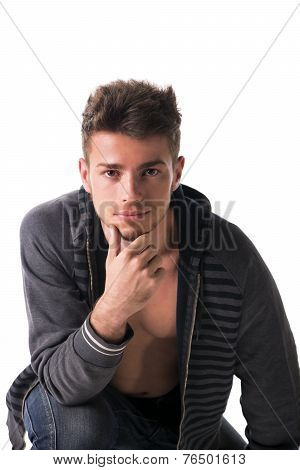 Beautiful Young Man In Hoodie Jacket Open On Naked Chest