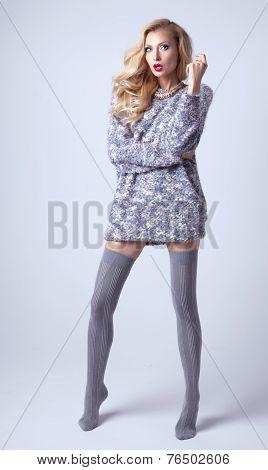 Attractive Blonde Woman Posing In Studio