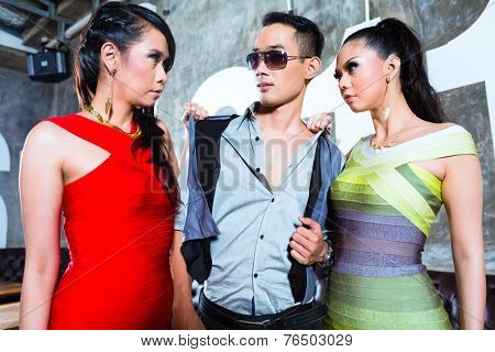 Jealous Asian party people women fighting for man in fancy and luxurious night club