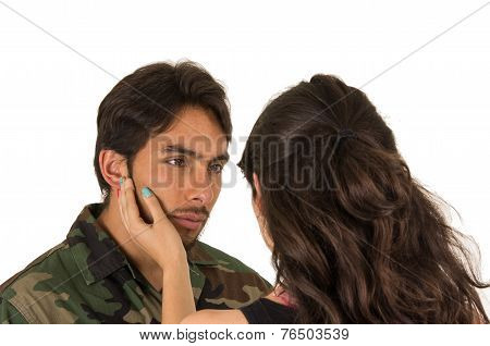 young hispanic military soldier saying goodbye to sad wife