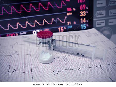 Bottle With Powder, Syringe, Ecg And Medical Monitor