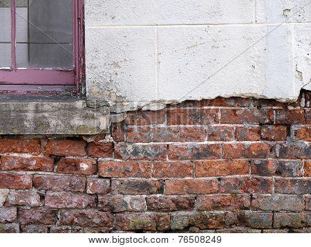 Crumbling Brickwork Of House