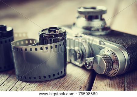Old Photo Film Rolls, Cassette And Retro Camera, Selective Focus.