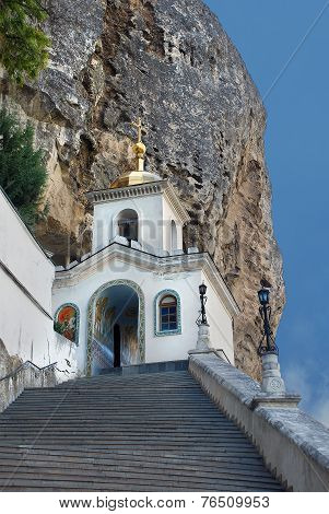 The stairs and passageway to the temple in the rock in Bakhchisarai Holy Assumption Monastery.