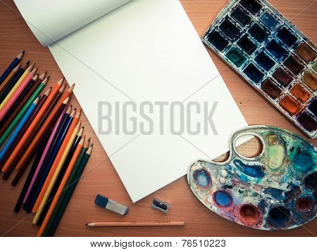 Office Tools, Colored Pencils And Watercolor On The Table