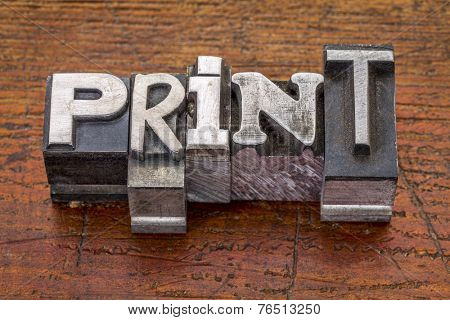 print word in vintage metal type printing blocks over grunge wood