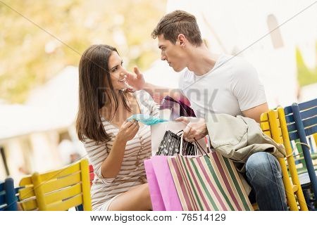 Couple In The Break After Shopping
