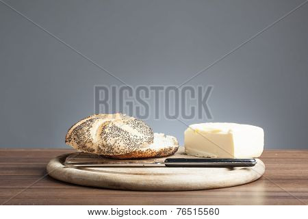 Poppy Seed Roll With Butter, Knife On Plate