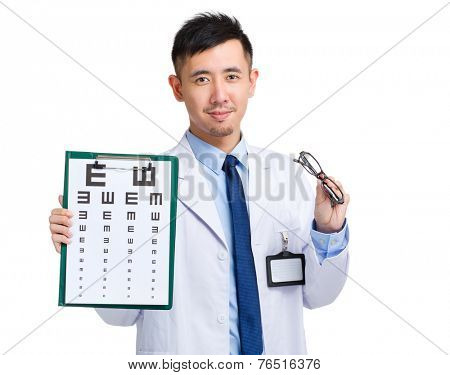 Optician with eye chart and glasses