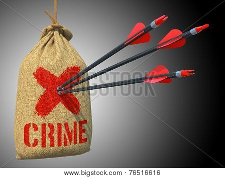 Crime - Arrows Hit in Red Target.