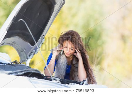 woman with a broken car