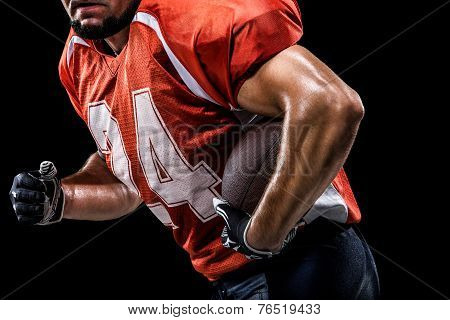 American football sportsman player is isolated on black