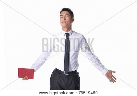 picture of a young business man holding book with his arms wide opened