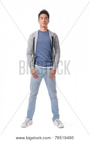young man standing full length isolated with hands in pockets posing