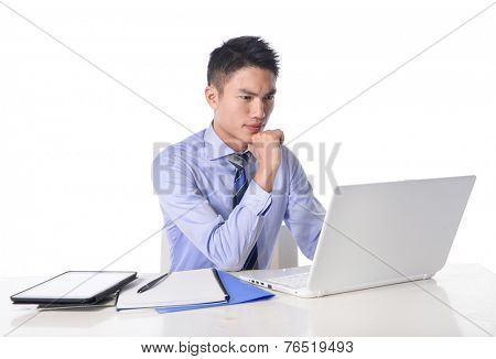 portrait of Young businessman working with a notebook in his office