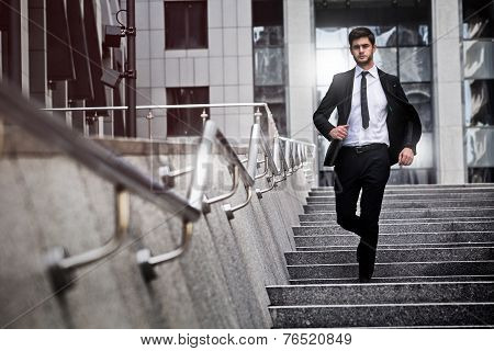 Business man is running away